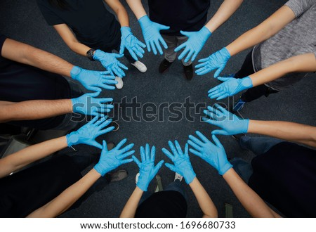 Close up group of hand with medical glove present Collaborate and teamwork, Volunteers hand