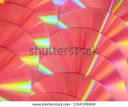 Close up group of pink DVD discs. Background from colorful compact disks. #1264188868