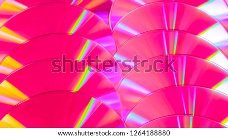 Close up group of pink DVD discs. Background from colorful compact disks. #1264188880
