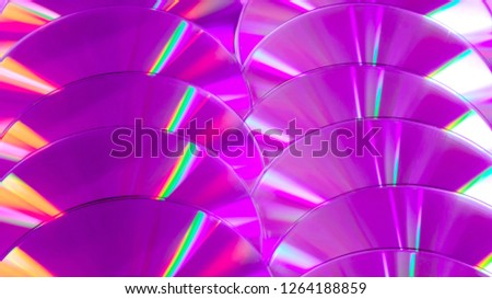 Close up group of violet and purple DVD discs. Background from colorful compact disks. #1264188859