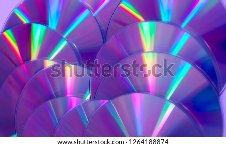 Close up group of violet and purple DVD discs. Background from colorful compact disks.