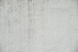close-up grunge gray concrete wall texture background, cement walls are decorated with plastering techniques to have rough surface like cement dripping for decoration exterior facade building wall