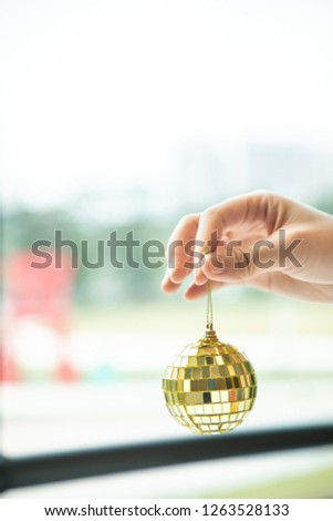 Close up hand held golden disco ball ready to decorate the venue