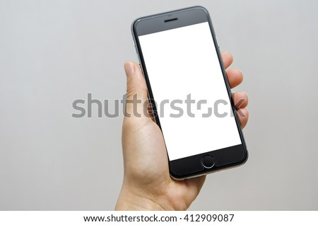 Close up hand holding black phone on white clipping path inside.
