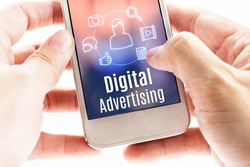 Close up hand holding mobile with Digital Advertising and icons, Digital Marketing concept.