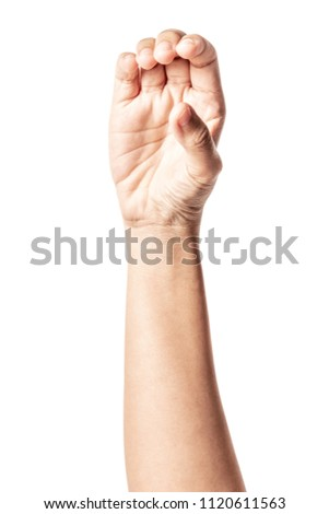 Close up hand holding something like a bottle or can isolated on white background