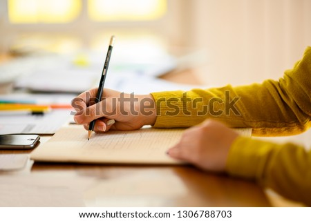 Close up hand of business woman and business friend investment consultant analyzing studying company annual financial report balance sheet statement working with documents  graphs laptop mobile phone