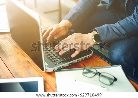 Close up hand of businessman using laptop working in office