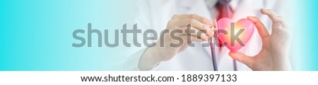 Close up hand of doctor hold and using stethoscope touch to examining heart, Health and care concept. Image standard horizontal web banners. Stockfoto ©