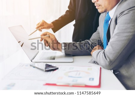 close up hand of marketing manager employee pointing at business document on laptop computer during discussion at meeting room  - Business concept #1147585649