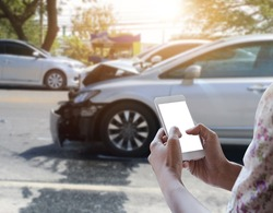 Close up hand of woman holding smartphone notification of car accident.
