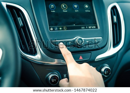 Close-up hand press the button to go Previous song, track or radio station on modern car #1467874022