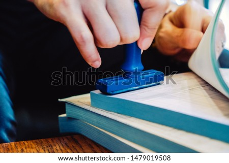 Close-up hand stamping rubber Stamp on a documents, business concept  #1479019508