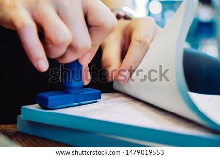Close-up hand stamping rubber Stamp on a documents, business concept  #1479019553