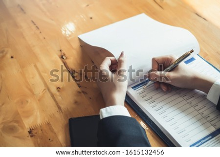 Close up. Hand Woman who are filling application form.