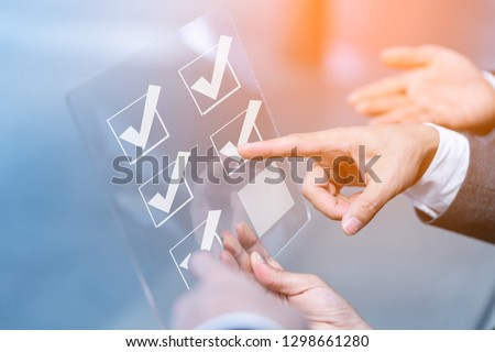 Close up hands businessman doing checking mark on checklist  on virtual touch screen. Customer service evaluation and technology customer support concept,mail,phone,email   #1298661280