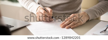 Close up hands hired female hold pen sign job contract, client receive insurance services, businesswoman affirm legal agreement make good deal concept horizontal photo banner for website header design