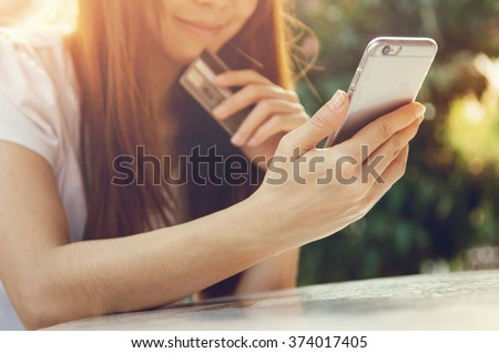 Close up hands holding credit card and using mobile smart phone outdoor, Online shopping, woman happy. #374017405