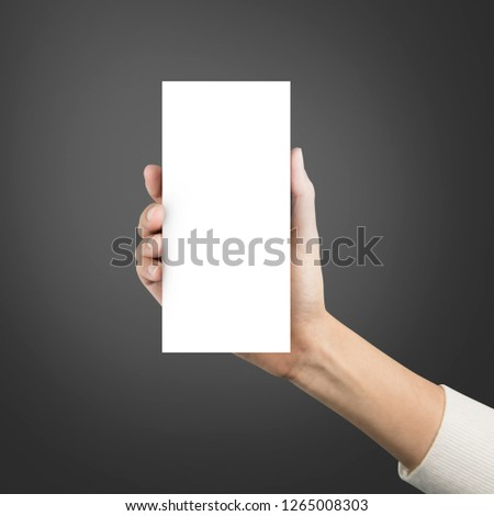 Close up hands holding paper blank brochure a4 three template on a grey background. #1265008303