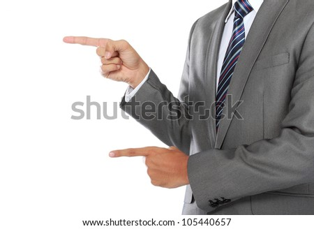close up hands of business man pointing his finger to the copyspace