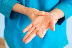 close up hands of old woman getting trigger finger from working