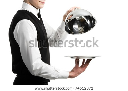 Close up hands of waiter with metal cloche lid cover