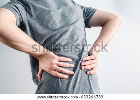 Close up hands touching back pain