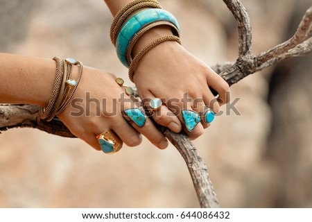 close up hands with boho accessories #644086432