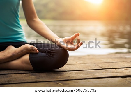 Close up hands. Woman do yoga outdoor. Woman exercising vital and meditation for fitness lifestyle club at the outdoors nature background. Healthy and Yoga Concept