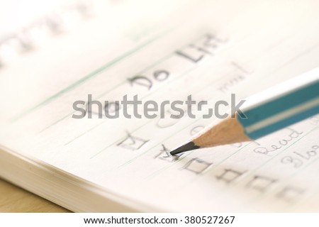 close up Handwritten to do list plan in a  small note book ,  extremely shallow DOF