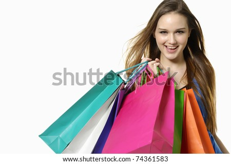 Close up happy shopping girl holding bags