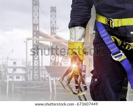 Close-up harnesses and gloves, Working at height equipment. Fall arrestor device for worker with double hooks for safety body harness on selective focus, Safety background and  beautiful, Safety first