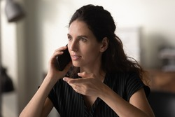 Close up head shot confident young woman holding smartphone, talking, making phone call, businesswoman consulting client, explaining, speaking, discussing project with colleague or business partner