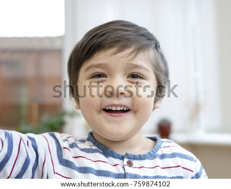 Close up head-shot of happy little boy, Portrait of kid looking at camera with big smiling face with blurry background, Happy and healthy child concept #759874102