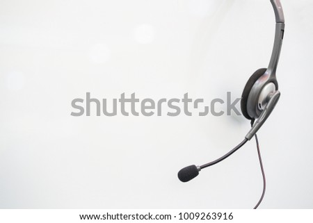close up headset call center hotline hanging at operation office room for operator helpline job concept