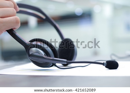 close up headset of call centre hotline at computer office room:operator helpline job:help-desk consult service.blur of assignment,business,technology concept:help desk support service worldwide.