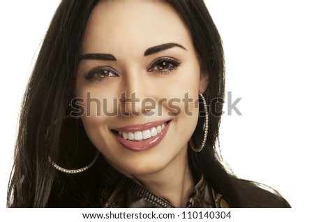 Close up headshot of a friendly beautiful smiling young with perfect white teeth