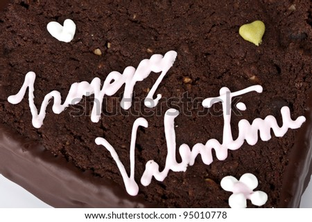 Close up heart shaped slice of a brownie on white background