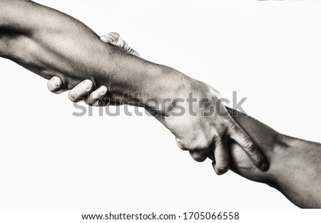 Close up help hand. Two hands, helping arm of a friend, teamwork. Rescue, helping gesture or hands. Black and white. Stock photo ©