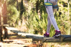 Close-up hiking boots in adventure park. Girl in adventure park
