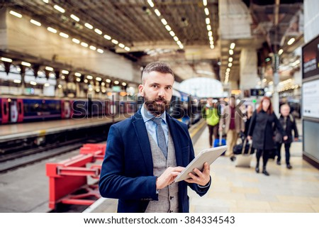 Close up, hipster businessman with tablet, train station #384334543