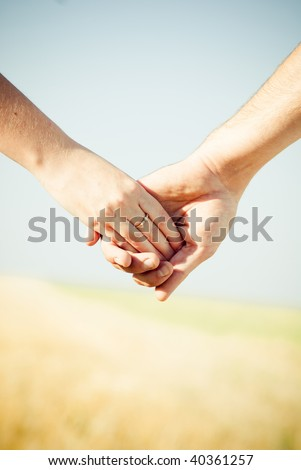 stock photo : Close-up Holding Hands with Wedding Ring