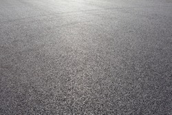 close-up horizontal view of new asphalt road