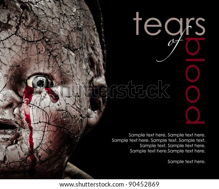 Close up Horror photo of a Cracked Scary Doll Crying Blood with text space to the right