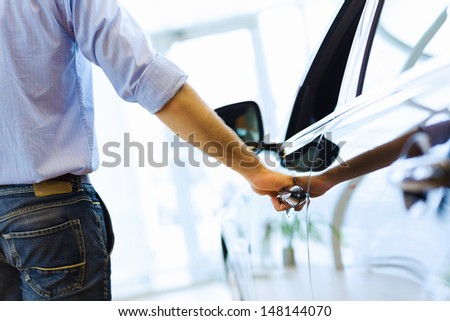 Close up human hand opening car door