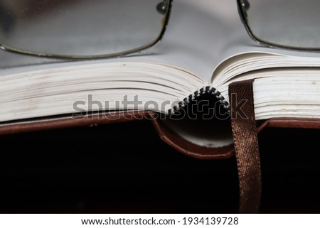 Close up image and selective focus and open boog with eyeglass on top Stockfoto ©