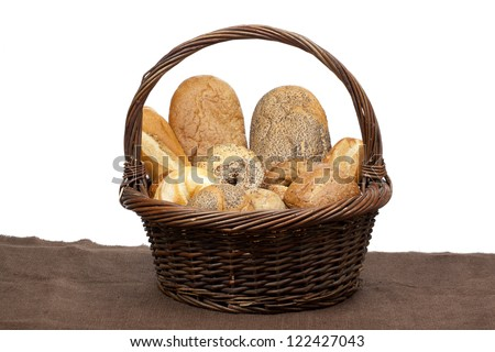 Close-up image of a basket of variety of bread over the white background