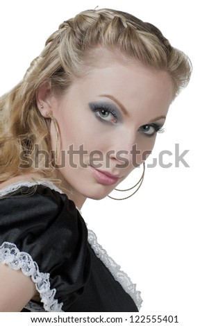 Close-up image of a beautiful maid looking at the camera on a white surface
