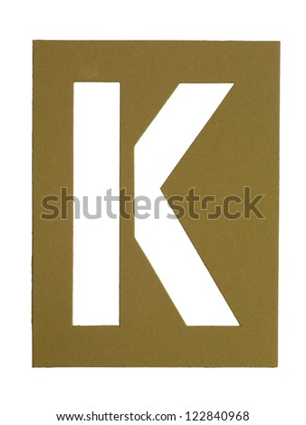 Close-up image of a cardboard with cut out letter K