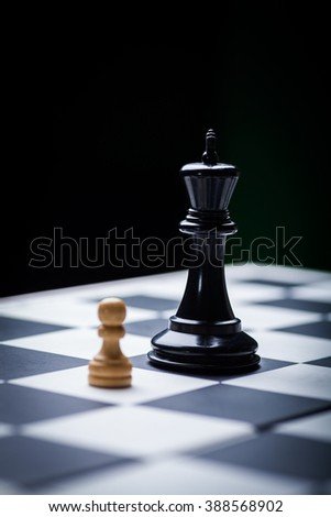 Close-up image of a chess board with chess pieces. #388568902